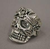 A silver skull ring