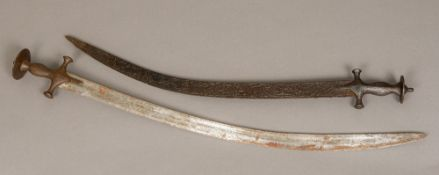 A Persian tulwar With typically curved polished steel blade;