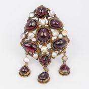 A Renaissance style cabochon, garnet and pearl gilt metal pendant/brooch 7.5 cm high.