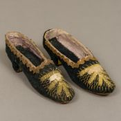 A pair of 19th century lady's heeled shoes Of small proportion, with thread and bead decoration.