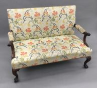 A late 19th/early 20th century 18th century style mahogany settee The overstuffed back issuing twin