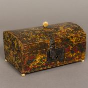 A late 18th century domed wooden box With marbleised paper decoration and bone finial,