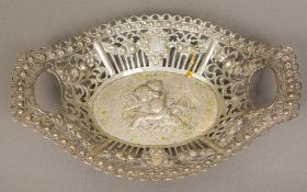 A Continental 800 silver basket Centrally worked with putti wrestling a dolphin. 22.5 cm wide.