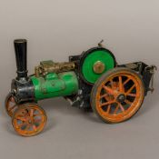 A vintage scale model of a steam plough engine 40 cm long.