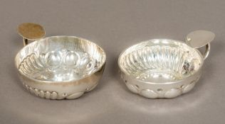 Two French silver wine tasters Of typical form. The larger 8 cm diameter.