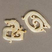 Two Chinese Waring States or Han Dynasty carved hardstone amulets Worked as stylised dragons.