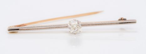 An unmarked 14 ct gold diamond solitaire bar brooch The central old cut stone approximately 0.