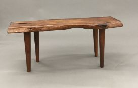 A Reynolds of Ludlow yewwood coffee table The naturalistic plank top supported on tapering legs,