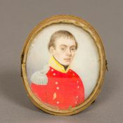 An early 19th century portrait miniature on ivory Depicting a young military officer in red tunic