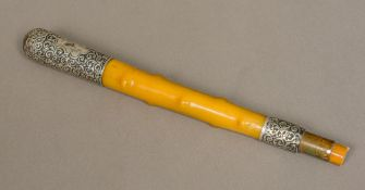 An early Edwardian silver mounted rhino horn parasol handle The silver top hallmarked for