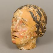A 19th century polychrome painted carved wooden head Modelled as a woman. 21 cm high.