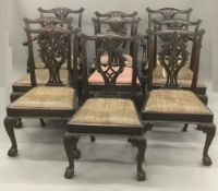A set of ten late 19th century Chippendale style mahogany dining chairs,