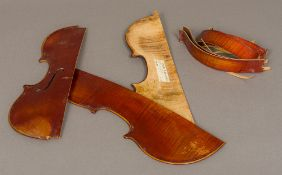 An early 20th century Italian violin in pieces (front treble side,