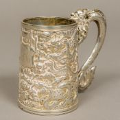 A late 19th/early 20th century Chinese silver tankard Of spreading cylindrical form with scrolling