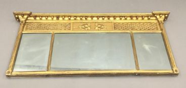An early 19th century gilt framed triple plate over mantle mirror The inverted breakfront beaded