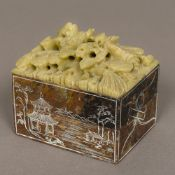 A Chinese carved soapstone box and cover Worked with a dragon and a phoenix above incised river