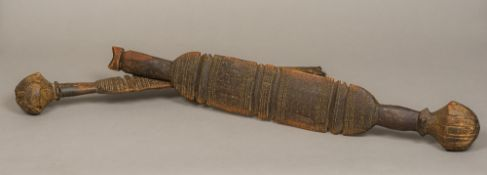 Two antique African Tuareg tribal carved wooden tent pole sections Each with bulbous knop and