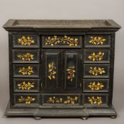 An 18th century ebonised table cabinet The breakfront cornice above an arrangement of twelve