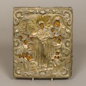 An 18th/19th century Russian gilt metal clad painted wooden icon Depicting the Virgin Mary and