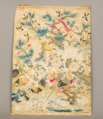 An 18th century Chinese embroidered silk panel Decorated throughout with various pairs of birds and