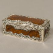 A 19th century unmarked silver mounted olive wood snuff box Of serpentine form, with shell,
