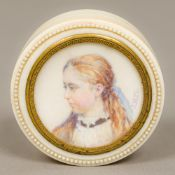 A 19th century portrait miniature inset turned ivory snuff box Of circular form,
