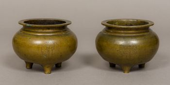 A pair of 19th century Chinese patinated bronze censers Each of squat circular form,