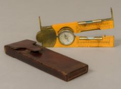 A Victorian brass mounted boxwood clinometer rule by Negretti & Zambra, London Of folding form,