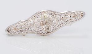 A 14K white gold and diamond brooch Of pierced navette form,