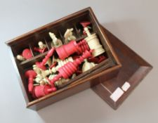 A 19th century bone and stained bone chess set Boxed. The kings each 15 cm high.