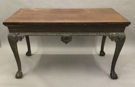 A 19th century mahogany serving table The rectangular top above the frieze with central foliate and