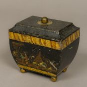 A 19th century toleware tea caddy The hinged top with lacquered brass finial,