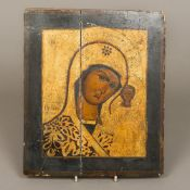 An 18th/19th century Russian painted and gilded wood icon Depicting the Madonna and Child 27 cm