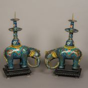 A pair of Chinese cloisonne type decorated pricket stick censers Modelled as elephants,