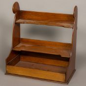 A 19th century mahogany shaped hanging shelves With fitted open drawer.