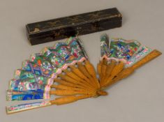 A 19th century Canton fan With carved and wooden guards and sticks,