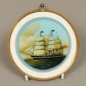 A 19th century reverse painted glass picture of a British three masted sailing ship Of circular