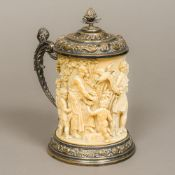 A 19th century carved ivory lidded tankard The tusk carved in the round with putti, birds,