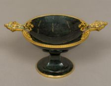 A silver gilt mounted carved hardstone pedestal tazza The mounts set with small diamonds and