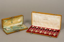 A Russian cased set of late 19th century silver gilt coffee spoons,