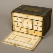 An 18th century chinoiserie lacquer and ivory table cabinet Of typical rectangular form,