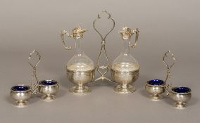 A 19th century French silver and glass condiment set Comprising: a double bottle stand with two