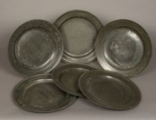 A set of six pewter chargers,