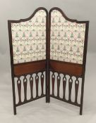 An Edwardian mahogany framed single fold screen The shaped fabric lined panels with integral hinged