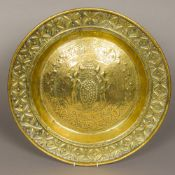 An antique, possibly 17th/18th century brass alms dish With repousse decoration,