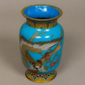 A late 19th/early 20th century cloisonne vase Decorated in the round on blue ground with a bird of