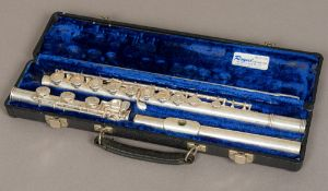 An American 20th century solid silver flute by Gemeinhardt, model 3S and numbered 624947 Cased.