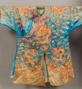 A 19th century Chinese embroidered silk robe Decorated with dragons amongst clouds,