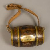 A small Hennessy Cognac barrel Of typical coopered form, mounted with leather dog strap. 17.