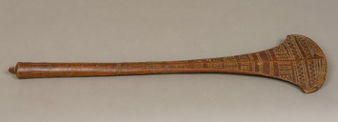 A 19th century Fijian Dui war club Of typical form, with carved geometric decoration. 69 cm long.